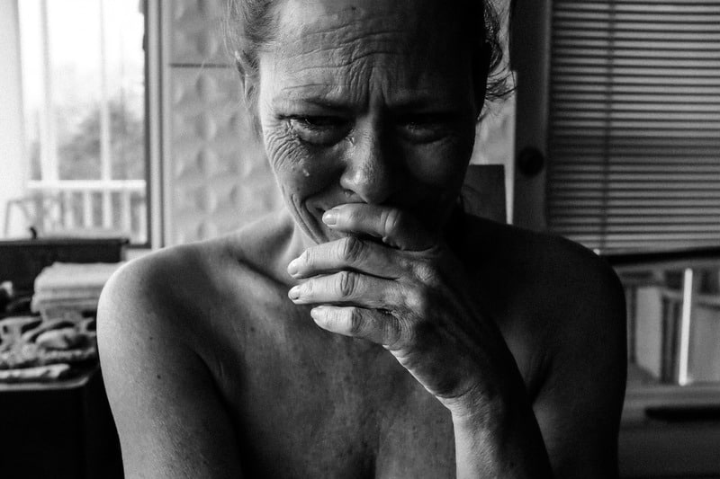 woman crying from depression due to menopause